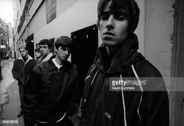 Manchester rock band Oasis London 17th March 1994 Left to right rhythm guitarist Paul 'Bonehead' Arthurs bassist Paul McGuigan drummer Tony McCarroll...