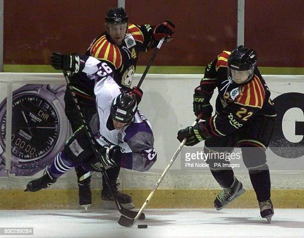 Manchester Storm's Rick Brabant is sent tumbling to the ice by Par Djoos of Brynas Tigers during their European Ice Hockey League match at the...