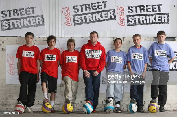 Manchester United and England's Wayne Rooney meets winners of the CocaCola street striker competition at Towngate Business Centre Walkden Manchester