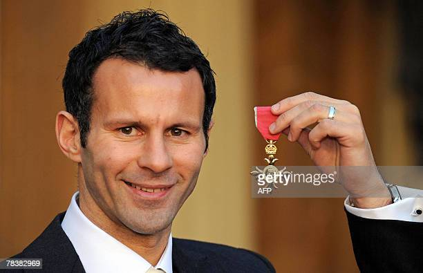 Manchester United and Wales footballer Ryan Giggs is pictured after receiving an Order of the British Empire for services to football by Queen...