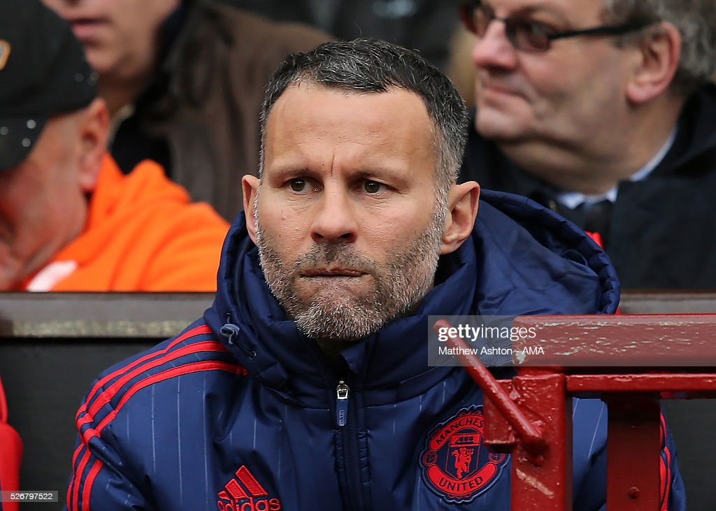 Manchester United Assistant Manager <a gi-track='captionPersonalityLinkClicked' href=/galleries/search?phrase=Ryan+Giggs&family=editorial&specificpeople=201666 ng-click='$event.stopPropagation()'>Ryan Giggs</a> looks on during the Barclays Premier League match between Manchester United and Leicester City at Old Trafford on May 1, 2016 in Manchester, United Kingdom.
