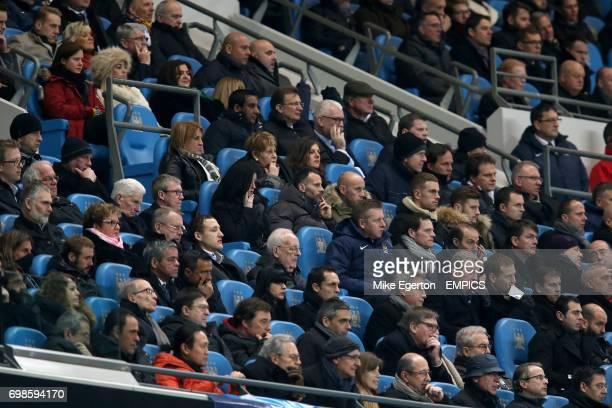 Manchester United assistant manager Ryan Giggs looks on from the stands alongside Nicky Butt Jordan Henderson and Adam Lallana