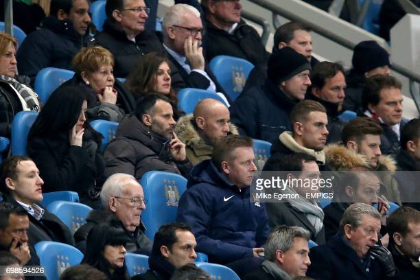 CROP* Manchester United assistant manager Ryan Giggs looks on from the stands alongside Nicky Butt Jordan Henderson and Adam Lallana