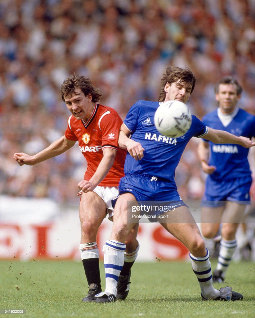 Manchester United captain Bryan Robson clashes with Paul Bracewell of Everton during the FA Cup Final between Manchester United and Everton at...