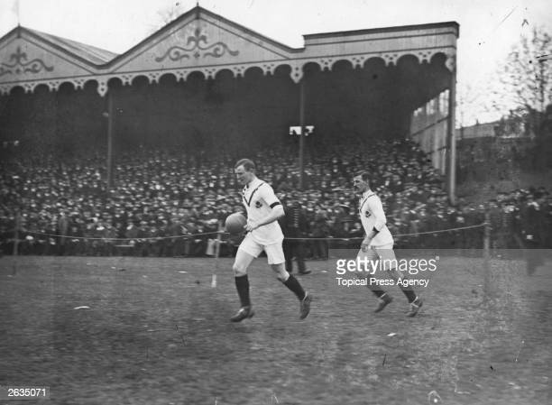 Manchester United captain Charlie Roberts leads his team out on to the pitch for the F A Cup Final of 1909 against Bristol City United went on to win...