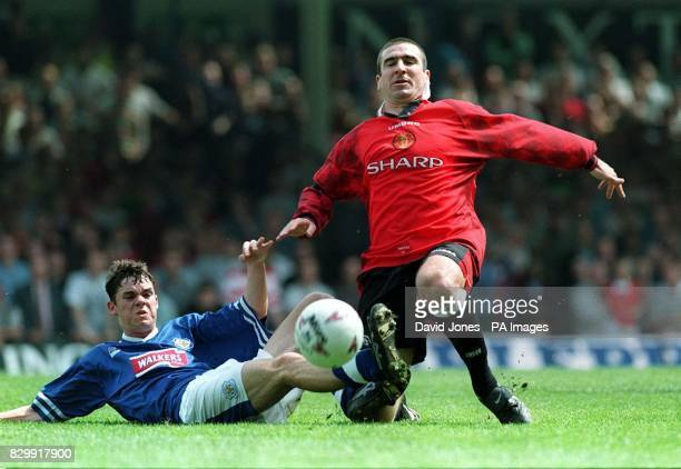 Manchester United captain Eric Cantona and Leicester City's Stuart Campbell in a midfield during today's FA Carling Premiership match at Filbert St...