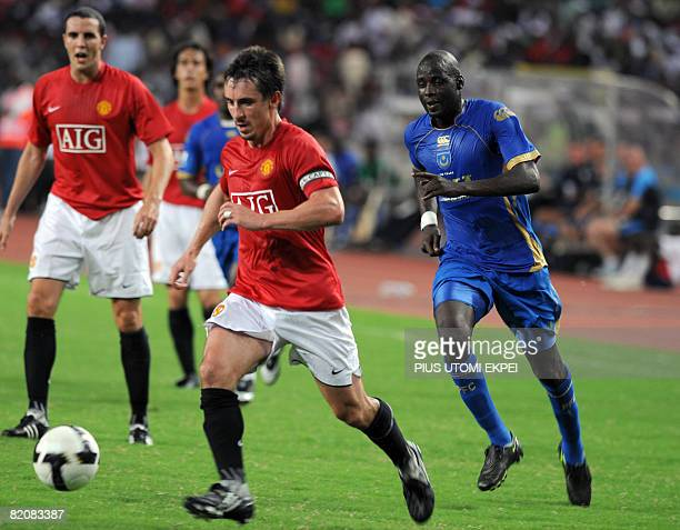 Manchester United Captain Neville Gary leads the attack into the Portsmouth half during the friendly football match between the two English...