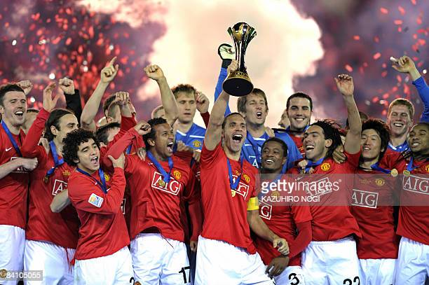 Manchester United captain Rio Ferdinand and teammates celebrate their win over Ecuador's Liga de Quito during an award ceremony at the FIFA Club...