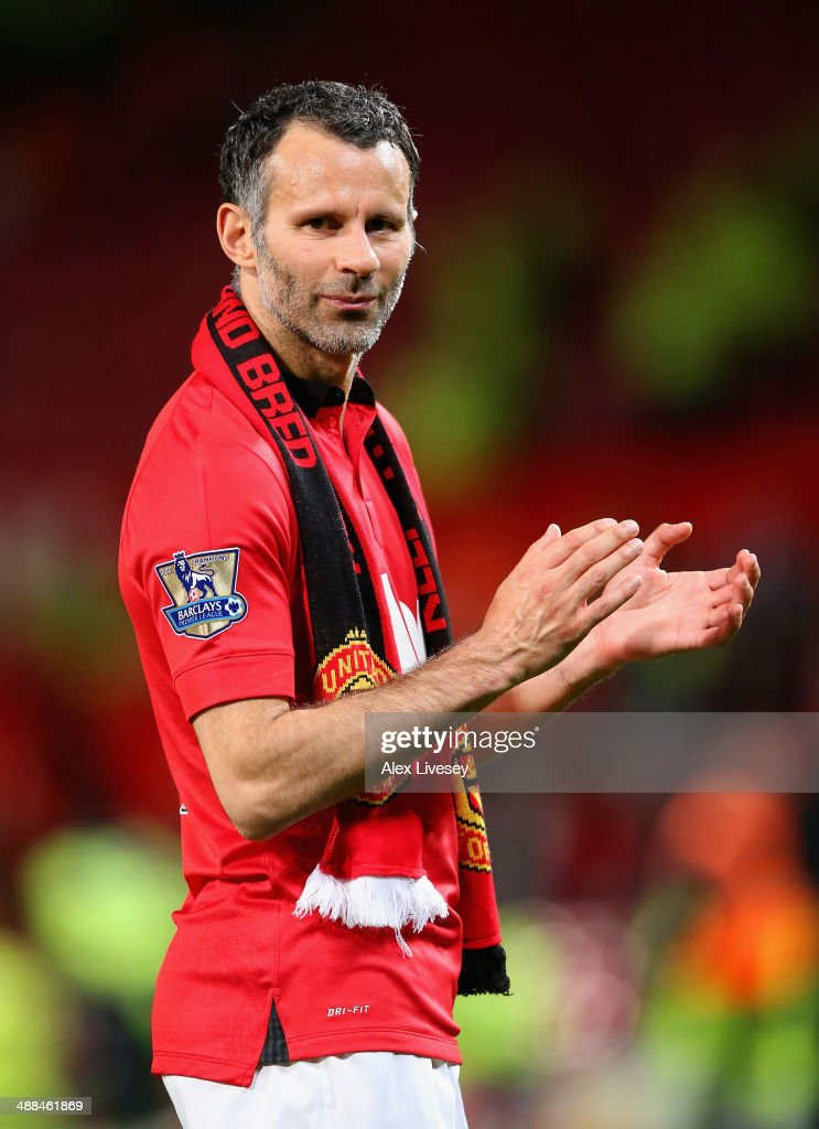 Manchester United Caretaker Manager <a gi-track='captionPersonalityLinkClicked' href=/galleries/search?phrase=Ryan+Giggs&family=editorial&specificpeople=201666 ng-click='$event.stopPropagation()'>Ryan Giggs</a> acknowledges the fans at the end of the Barclays Premier League match between Manchester United and Hull City at Old Trafford on May 6, 2014 in Manchester, England.