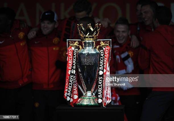Manchester United celebrate behind the Barclays Premier League trophy during the Manchester United Premier League Winners Parade at Manchester Town...