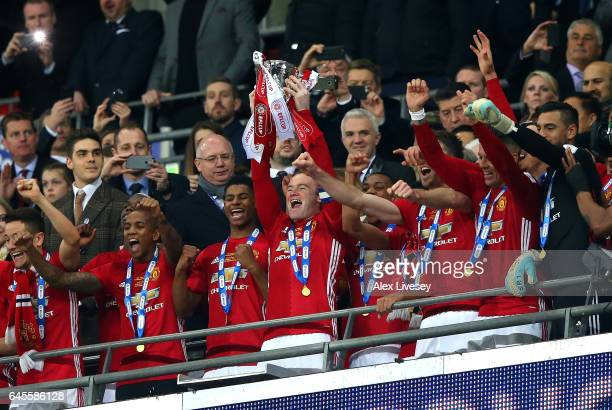 Manchester United celebrate victory with the trophy after during the EFL Cup Final between Manchester United and Southampton at Wembley Stadium on...
