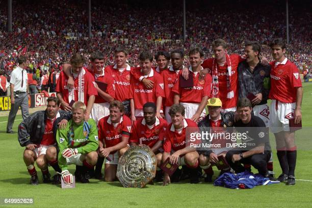 Manchester United celebrate with the Charity Shield Andrei Kanchelskis Roy Keane Lee Sharpe Denis Irwin Ryan Giggs Paul Ince Bryan Robson Gary...