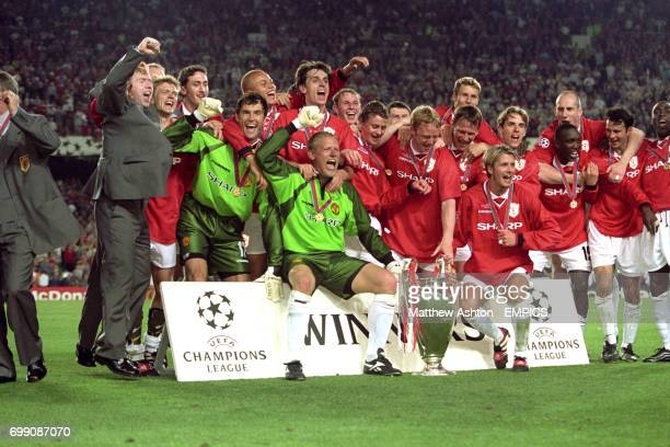 Manchester United celebrate with the European Cup Paul Scholes Jesper Blomqvist Jonathan Greening Raimond van der Gouw Wes Brown Gary Neville Peter...