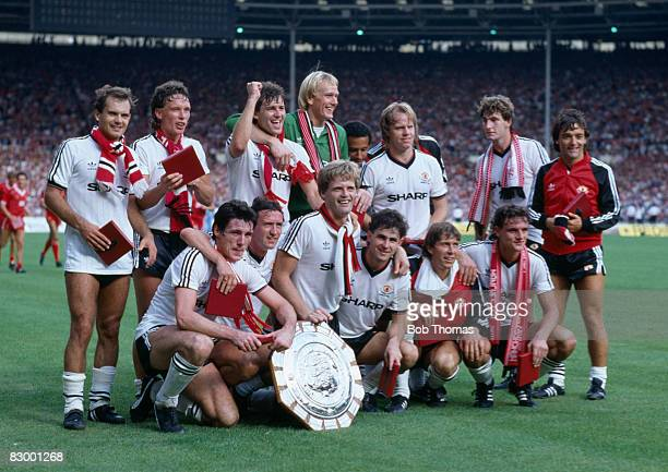 Manchester United celebrate with the FA Charity Shield after their 20 victory over Liverpool at Wembley Stadium August 20th 1983 Back row Ray Wilkins...