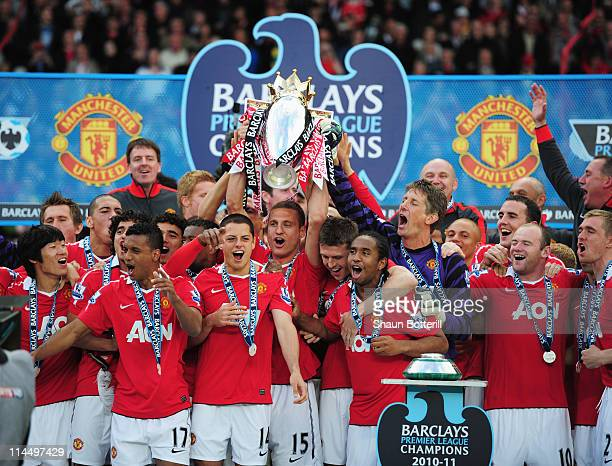 Manchester United celebrate with the Premier League trophy after the Barclays Premier League match between Manchester United and Blackpool at Old...