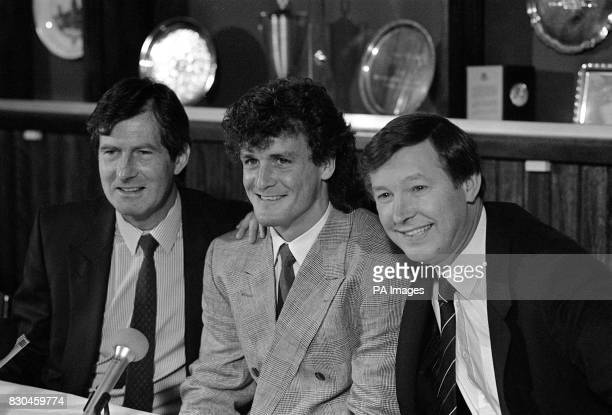 Manchester United chairman Martin Edwards and manager Alex Ferguson with forward Mark Hughes at Old Trafford where the Wales and Barcelona striker...