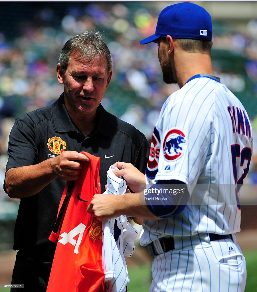 Manchester United Club Ambassador Bryan Robson exchanges jersey's with Justin Grimm of the Chicago Cubs before the game between the Chicago Cubs and...