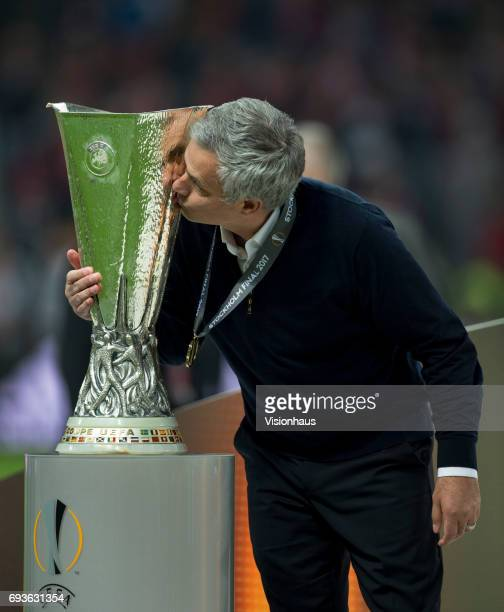 Manchester United coach Jose Mourinho kisses the trophy after the Europa League Final between Manchester United and AFC Ajax at the Friends Arena on...