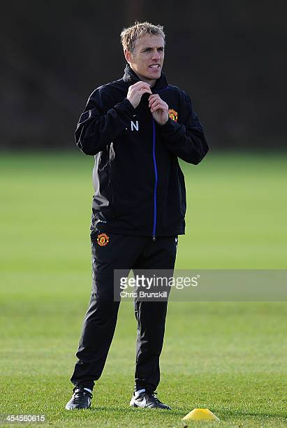 Manchester United coach Phil Neville looks on during a first team training session ahead of their UEFA Champions League Group A match against...