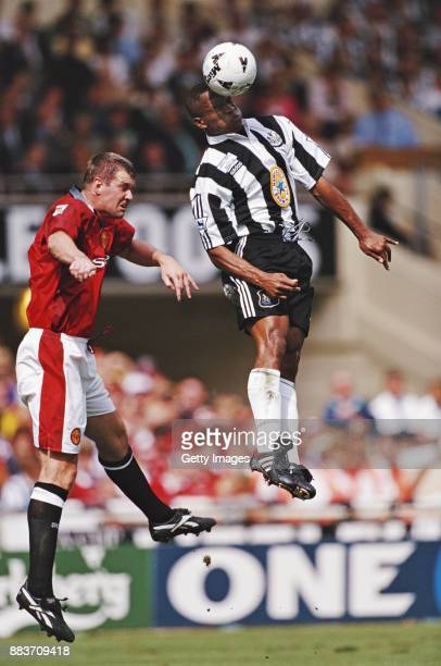 Manchester United defender Gary Pallister challenges Newcastle United striker Les Ferdinand during the 1996 FA Charity match at Wembley Stadium on...