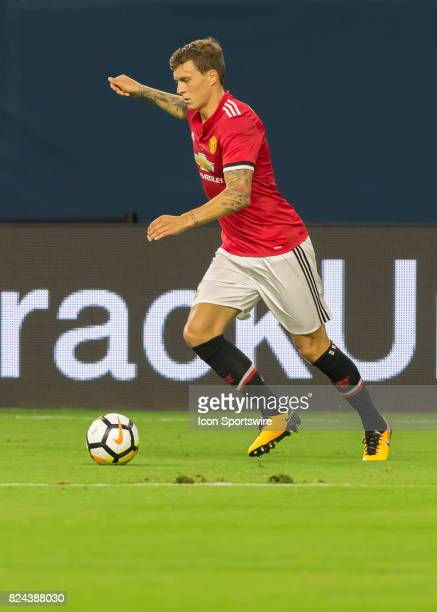 Manchester United defender Victor Lindelöf pushes the ball during the International Champions Cup match between Manchester United and Manchester City...