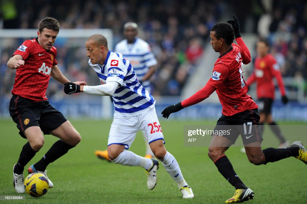 "Manchester United English midfielder Michael Carrick (L) and Portuguese midfielder Nani Nani (R) challenge Queens Park Rangers' English forward Bobby Zamora during the English Premier League football match between Queens Park Rangers and Manchester United at Loftus Road in London on February 23, 2013. Manchester United won the match 2-0. AFP PHOTO/OLLY GREENWOOD USE. No use with unauthorized audio, video, data, fixture lists, club/league logos or ""live"" services. Online in-match use limited to 45 images, no video emulation. No use in betting, games or single club/league/player publications"