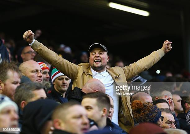 Manchester United fan cheers during the Barclays Premier League match between Liverpool and Manchester United at Anfield on January 17 2016 in...