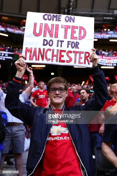 Manchester United fan displays a banner during the UEFA Europa League Final match between Ajax and Manchester United at Friends Arena on May 24 2017...