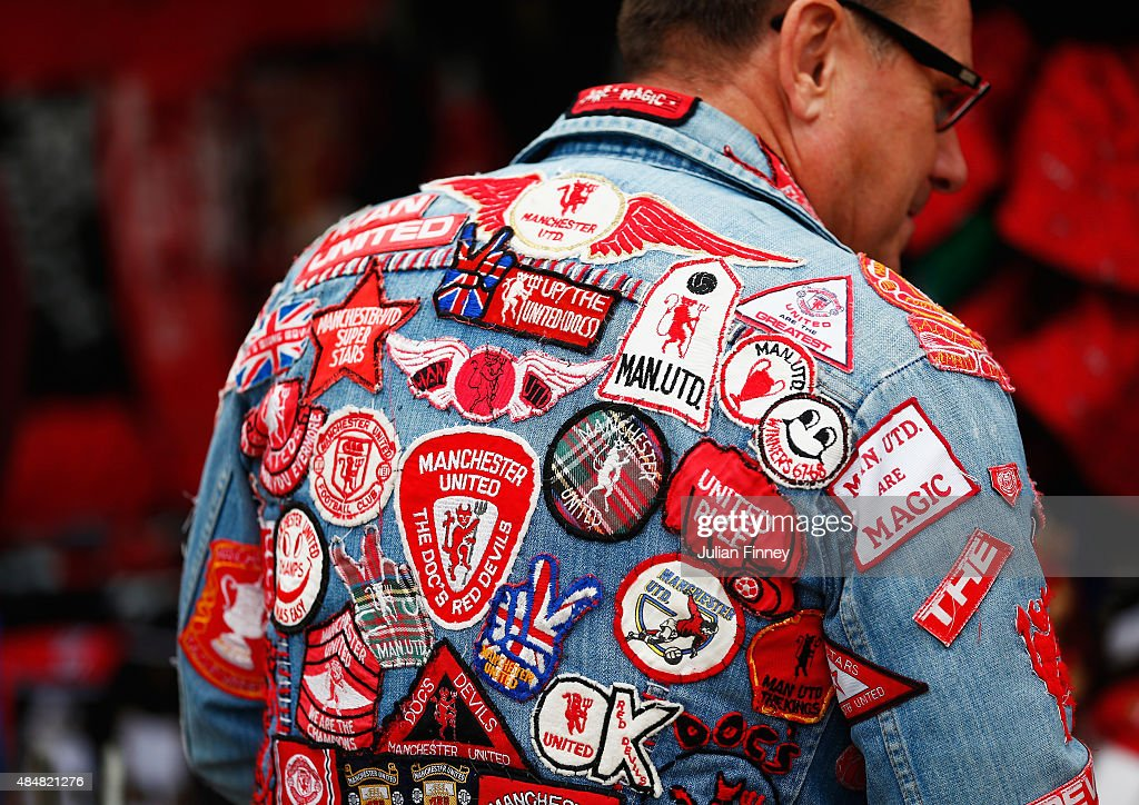 Manchester United fan displays a selection of badges prior to the Barclays Premier League match between Manchester United and Newcastle United at Old...