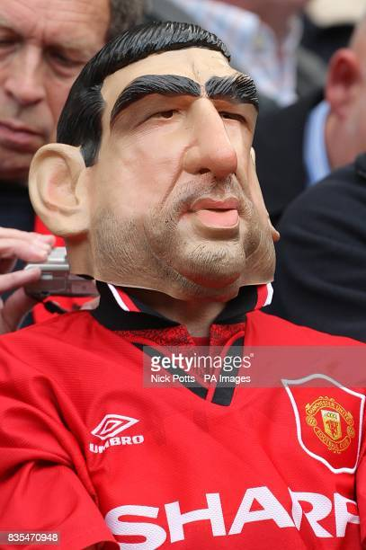 A Manchester United fan dressed as Eric Cantona in the stands