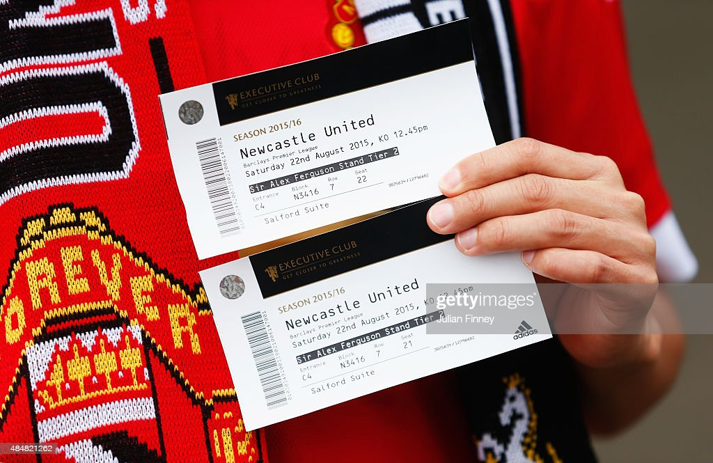 Manchester United fan holds two match tickets prior to the Barclays Premier League match between Manchester United and Newcastle United at Old...