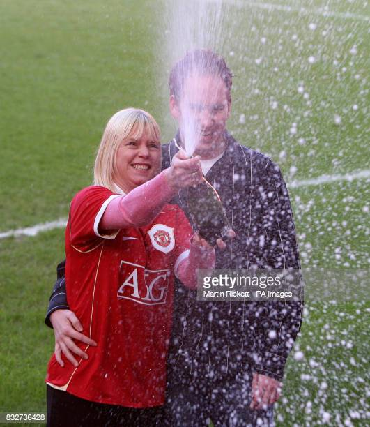 Manchester United fan Karen Child celebrates her 84 million lottery win with fiance Wayne Smith at Old Trafford Manchester