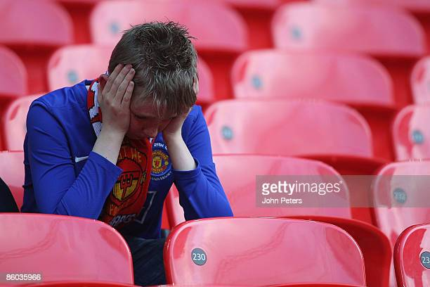 Manchester United fan looks dejected after the FA Cup sponsored by eon SemiFinal match between Everton and Manchester United at Wembley Stadium on...