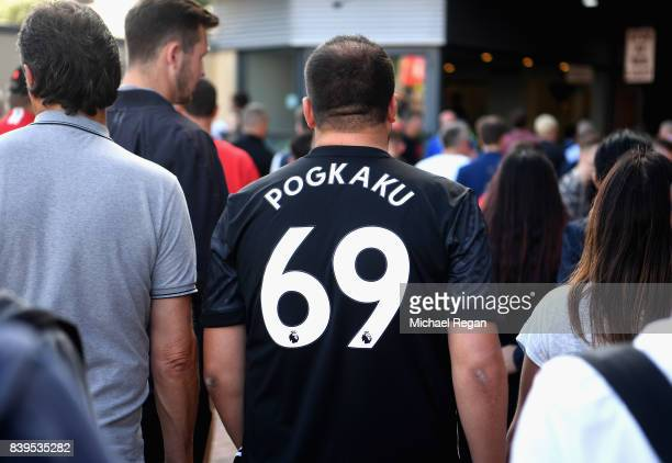 Manchester United fan makes his way to the stadium prior to the Premier League match between Manchester United and Leicester City at Old Trafford on...
