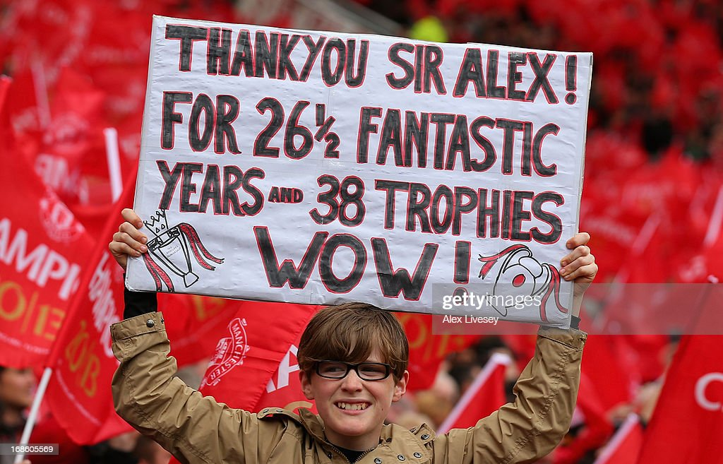 A Manchester United fan shows off a banner to honour Manager Sir Alex Ferguson prior to the Barclays Premier League match between Manchester United and Swansea City at Old Trafford on May 12, 2013 in Manchester, England.