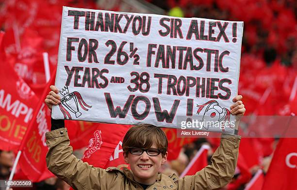 Manchester United fan shows off a banner to honour Manager Sir Alex Ferguson prior to the Barclays Premier League match between Manchester United and...