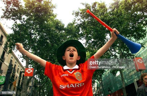 Manchester United fan Thomas Foulds from Manchester celebrates in Barcelona his side's victory against Bayern Munich in the UEFA European Champions...