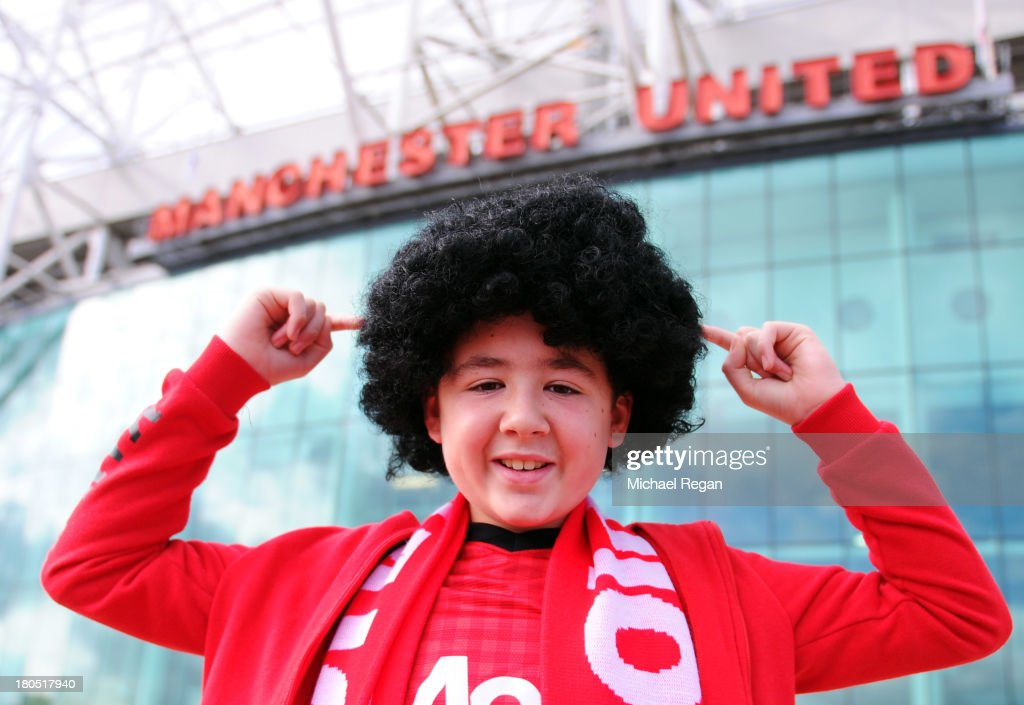 A Manchester United fan wears a wig to show his support for new signing Marouane Fellaini prior to the Barclays Premier League match between Manchester United and Crystal Palace at Old Trafford on September 14, 2013 in Manchester, England.
