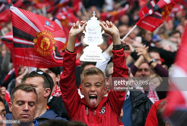 Manchester united fan with a homemade FA Cup trophy during The Emirates FA Cup final match between Manchester United and Crystal Palace at Wembley...