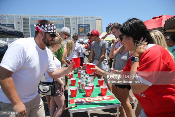 Manchester United fans and Real Madrid fans plat beer pong prior to the International Champions Cup 2017 match between Real Madrid v Manchester...