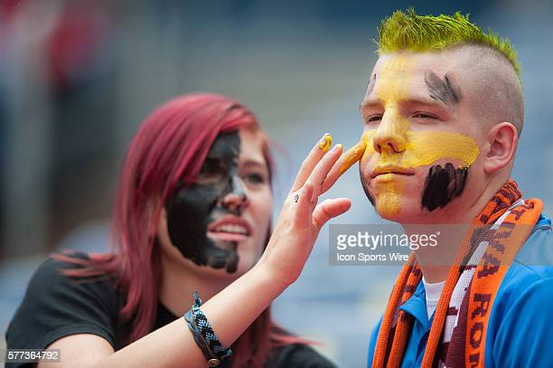 Manchester United fans apply face paint before a Guinness International Champions Cup game between the Manchester United and AS Roma at Sports...