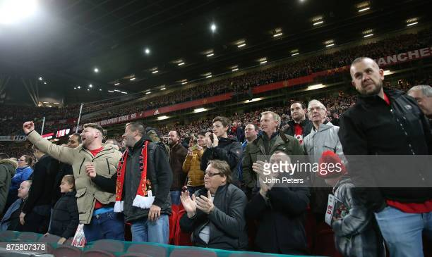 Manchester United fans celebrate Anthony Martial of Manchester United scoring their first goal during the Premier League match between Manchester...