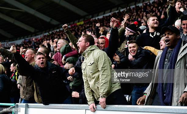 Manchester United fans celebrate the opening goal during the Barclays Premier League match between Swansea City and Manchester United at Liberty...