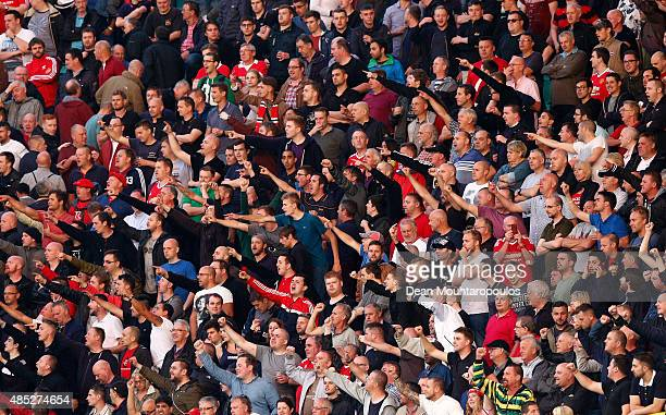 Manchester United fans cheer during the UEFA Champions League qualifying round play off 2nd leg match between Club Brugge and Manchester United held...
