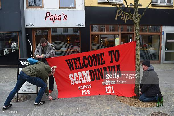Manchester United fans display a banner in protest at high away ticket prices prior to the UEFA Europa League round of 32 first leg match between FC...