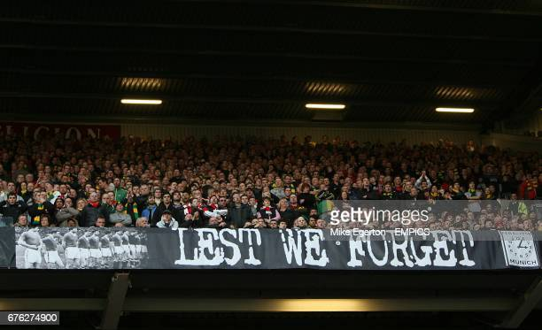 Manchester United fans display a Lest We Forget banner in the stands in Memeory of those who lost their lives in the Munich Air Disaster