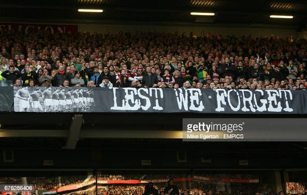 Manchester United fans display a Lest We Forget banner in the stands in Memory of those who lost their lives in the Munich Air Disaster