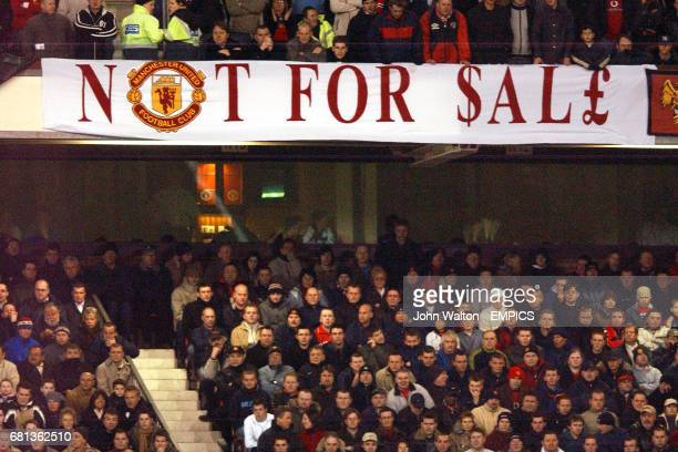 Manchester United fans display a message regarding their club