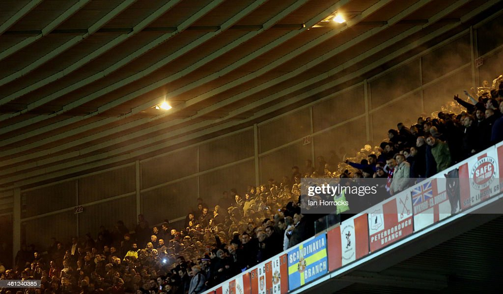 Manchester United fans let off smoke flares to celebrate their goal during the Capital One Cup Semi-Final, First Leg match between Sunderland and Manchester United at The Stadium of Light on January 07, 2014 in Sunderland, England.