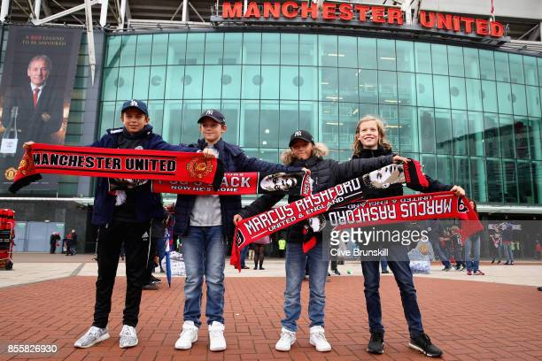 Manchester United fans pose for a team photo prior to the Premier League match between Manchester United and Crystal Palace at Old Trafford on...